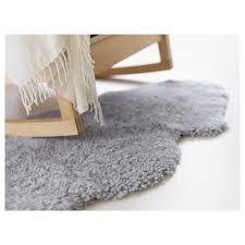 grey faux sheepskin rug plus rocking chair for home interior