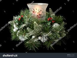 christmas table centerpiece hurricane glass glowing stock photo