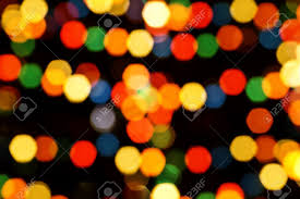 multi colored tree lights bokeh background stock photo