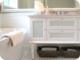 vintage bathroom design white wooden vanity with carved white wooden base near white