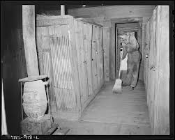 file cleaning up the locker room in the bathouse at the mine