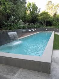 Modern Lap Pool Raised Lap Pool Swimming Pool Shades Of Green - Backyard lap pool designs