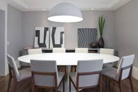 casual arranged room with pendant lighting above dining rooms