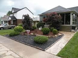landscaping with rocks and pots in sleek rocks and front yard