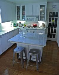 carrara marble kitchen island the granite gurus an with a carrara marble kitchen owner