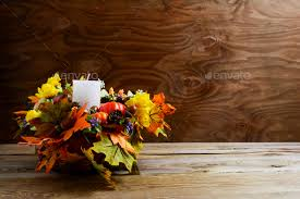 thanksgiving decoration with silk leaves on rustic background stock