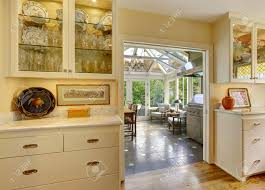 kitchen room with exit to patio area in sunroom kitchen cabinets