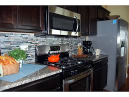 Stone Backsplash For Kitchen by Captivating Kitchen Stone Backsplash Dark Cabinets White Tile