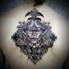 tattoo back face david hale tattoo rhombus back piece with face tattoomagz