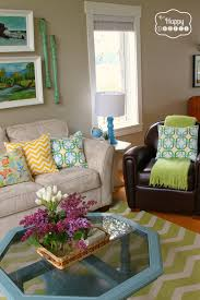 Living Room Pillows by Spring Ifying The Living Room Living Rooms Dark Brown Couch