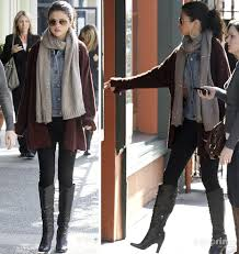 selena gomez wearing oversized cardigan over jean jacket with