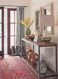 Drapes Over French Doors - white walls bleached wood mirrors colorful persian rug