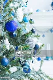 tree decorated with blue and silver balls stock photo