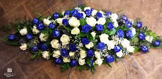white and blue roses casket spray white and blue roses ref s106 azalea flowers