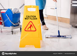Wet Floor Images by Yellow Wet Caution Sign On Wet Floor In Kitchen U2014 Stock Photo
