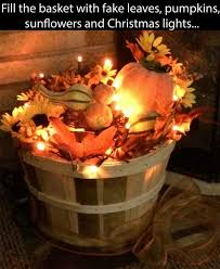 fills basket with fake leaves pumpkins sunflowers and christmas