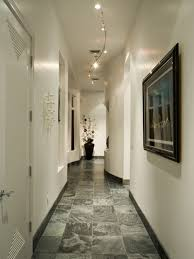 amazing hallway with white walls and framed wall picture also