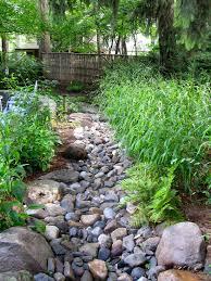 exterior design asian landscape river rock in dry river creek bed