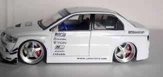 mitsubishi lancer evo 1 jada toys import racer mitsubishi lancer evolution viii 1 24 scale