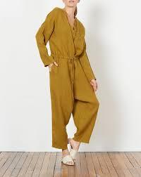 black crane jumpsuit v jumpsuit in mustard black crane covet lou