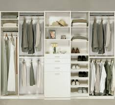 Walk In Closet Shelving by Bedroom Closet In An Antique White finish Melamine With Tilt Out