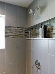Glass Tile Bathroom Backsplash by This Gray Contemporary Bathroom Features A Double Vanity Design
