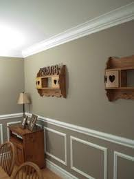 Wainscoting Ideas For Dining Room by Two Tone Wall With Chair Rail And Dark Hardwood Dining Room