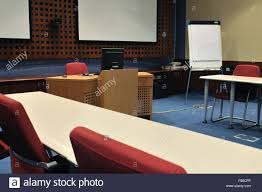 video conference room with chairs and big board projector canvas