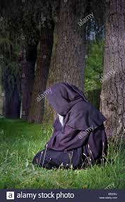 creepy halloween pictures creepy halloween monk in black cloak sitting in a forest stock