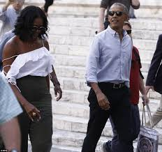 former us first lady michelle obama stuns in an off shoulder white