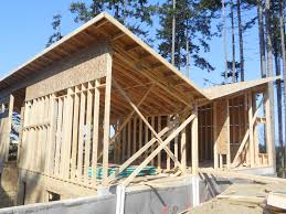 butterfly house april 24th main floor roof trusses garage and basement suite side