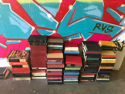 exploration fuels empathy book wall mural oak city mural co i also needed to figure out a system of organizing the books as i built them in the warehouse ultimately i would be disassembling the entire wall and