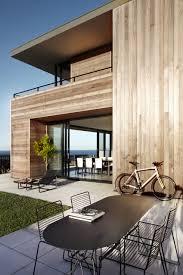 modern beach house camouflaged as driftwood box lamble residence