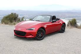 mazda will reveal a hardtop version of its new mx 5 miata in new york