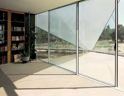 green tinted glass wall with frosted sliding door interior free