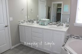 keeping it simple master bathroom makeover with gray and white