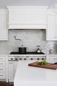 how to cut ceramic tile around kitchen cabinets 50 white herringbone backsplash tile in style white