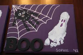 diy halloween spider hand print and ghost foot print canvas