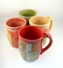 buy hand made four coffee mugs set artistic carved and glazed