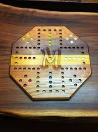 huh 4 person walnut aggravation board game 75 00 via etsy