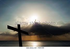 religious cross with sun in sky stock photos religious cross