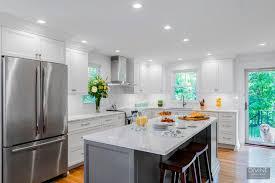 white kitchen cabinets grey island boston light and bright transitional kitchen grey island