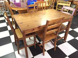 a pine kitchen dining table with four pine chairs