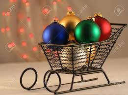 a christmas sleigh of blue gold green red and white ball