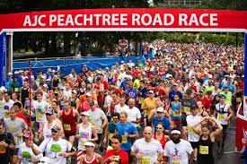 thanksgiving atlanta half marathon media credentials peachtree road race atlanta track club