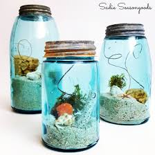coastal summer beach decor using a vintage aqua mason jar sand