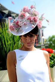 racegoers in feathered visors and butterfly hats get royal ascot