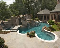 Backyard Pool With Lazy River by Extreme Backyards Luxury Pools