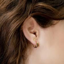tight hoop earrings rashida jones small square hoop earrings iconery