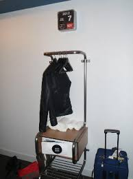 the small coat rack with the digital safe opposite the door to